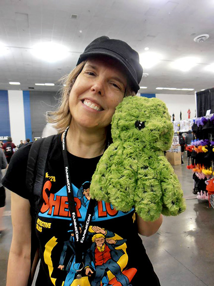 In the dealers' room with a Cthulhu plushie. Who knew an elder god could be so huggable?