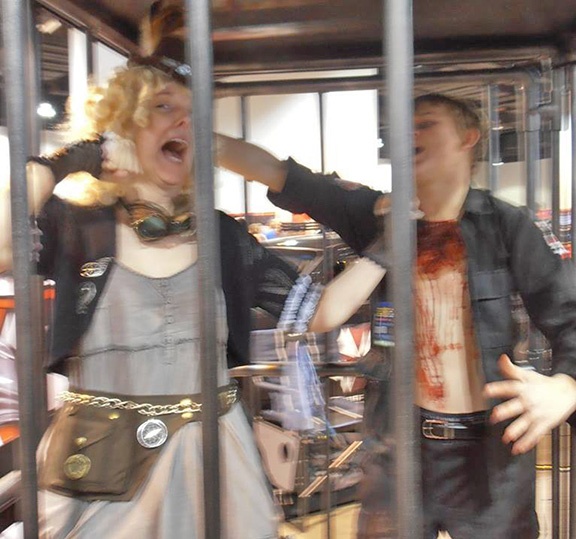 I asked the zombie's permission before entering his cage. He rewarded me by trying to eat my brains!